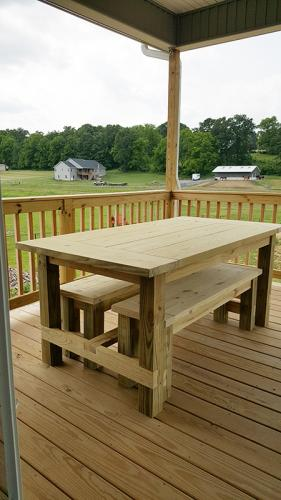 Farmhouse table with benches recessed, unfinished.